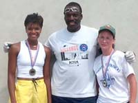 Singles Finalists Tracy and Theresa receive medals from ICHA President Paul Williams