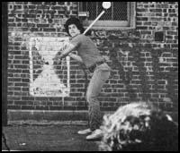Boy at bat playing fast-pitch stickball