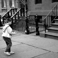 Boy plays stoopball