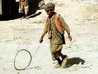 Afghan child playing with hoop