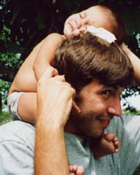 David with sleeping baby on head