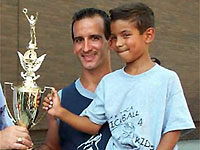 Steve Mercado with Skyler accepting the Stickball Classic Trophy.